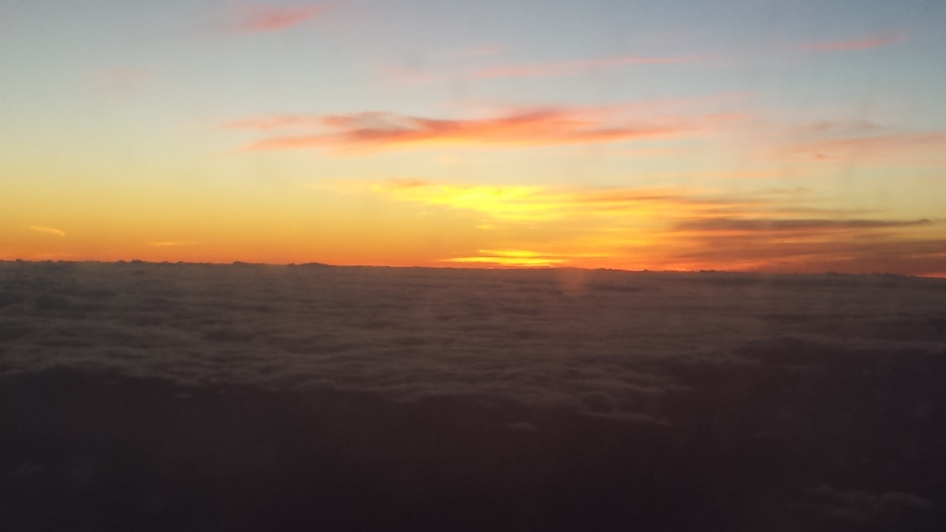 Hawaiian sunrise from above the clouds.