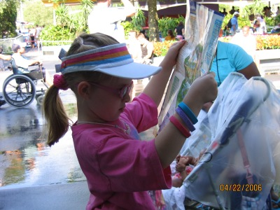 My formerly brave little rider, scoping out her next attraction (2006)