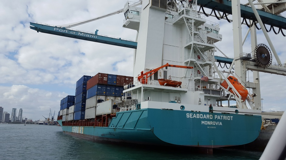 Container ship being unloaded
