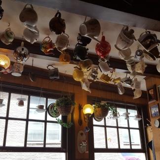 Upstairs Pannenkoeken Amsterdam teapots on ceiling