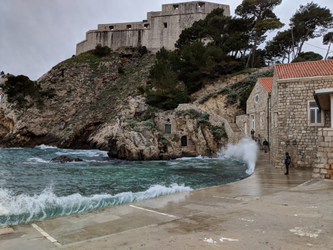 Note the people trying to time the waves on the stairs - a dicey proposition!