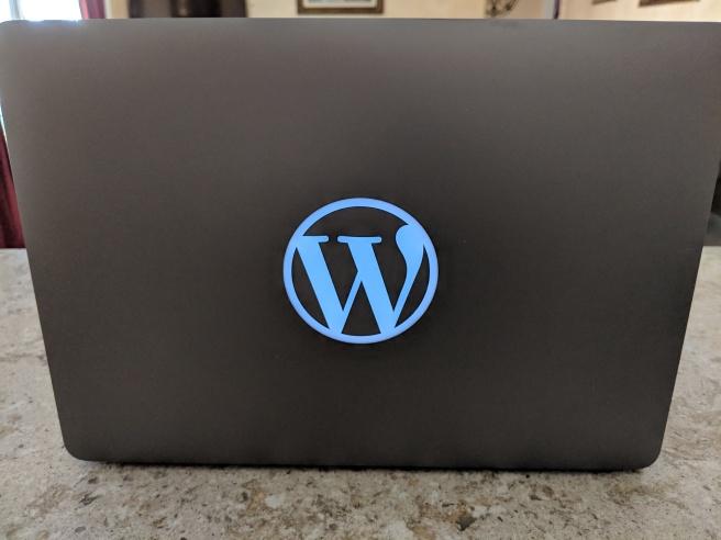 WordPress logo on Macbook pro
