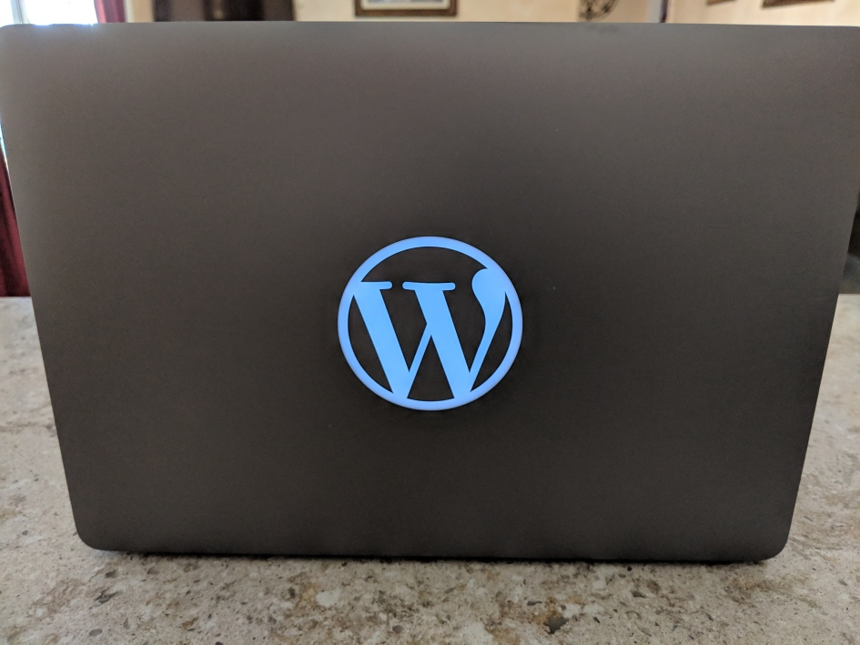 WordPress logo on Macbook pro